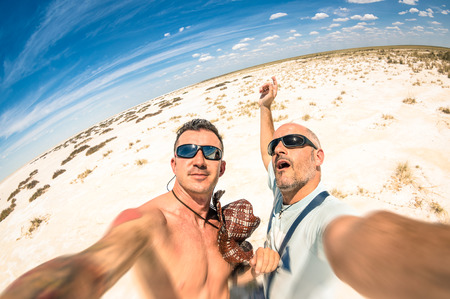 Hipster best  friends taking a selfie at Etosha national park in Namibia - Adventure travel lifestyle enjoying moment and sharing happiness - Trip together around the world as alternative lifestyle 版權商用圖片 - 35428838