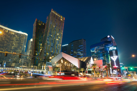 LAS VEGAS - DECEMBER 7, 2013: blurred lights on the Strip at sunset. Aria Resort and Casino is a luxury accomodation building, part of City Center complex on the Las Vegas Boulevard in Nevada Usa 에디토리얼