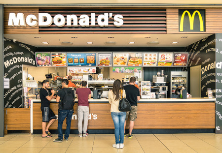 mc: RIMINI, ITALY - MAY 30, 2014: people waiting for the food service at Mc Donalds desk in the shopping mall  Le Befane  . The fast food company was founded in 1940 in San Bernardino, California.