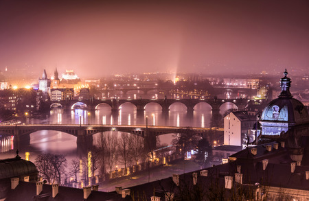 moldovan: Prague and Vltava river from Letna Hill - Romantic view after misty sunset with emotional marsala color filter - European capital of bohemian Czech Republic Stock Photo