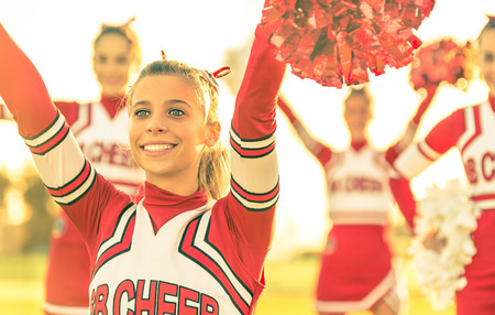 cheerleading squad: Portrait of a cheerleeder in action Stock Photo