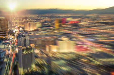 sunshine state: Aerial view of Las Vegas skyline at sunset - Blurred city lights from downtown strip boulevard - Vintage filtered look with radial zoom defocusing
