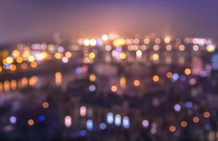 Defocused bokeh of Prague and Vltava river from Letna Hill - Romantic view after misty sunset with emotional color filter - European capital of bohemian Czech Republic photo