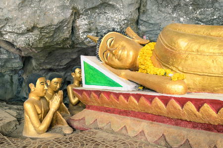 cave exploring: Reclining Buddha statue in the Elephant Cave ( Tham Sang ) near Vang Vieng - Exploring Lao PDR on exclusive destination - Day excursion around the sightseeing beauties of north of Laos