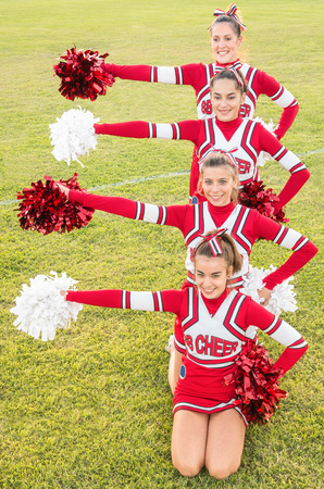 cheerleading squad: Happy Cheerleaders during Exhibition