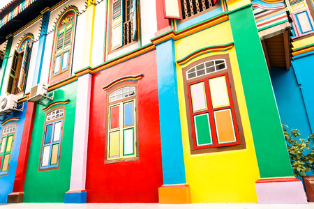 tilted view: Tilted perspective of colorful house facade of ancient traditional buildings in Little India - World famous multicolored district in Singapore - Travel concept and sightseeing around asia destinations Stock Photo