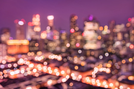 Bokeh filter of Singapore skyline from above during the blue hour - Asian modern city scape with spectacular nightscape panorama - Blurred defocused night lights on a violet marsala filtered editing