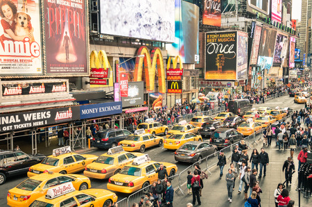 NEW YORK - DECEMBER 22, 2014: taxicabs and traffic jam congestion in front of Mc Donalds in Times Square in Manhattan, New York. Times Square is one of the world Редакционное