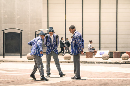 township: JOHANNESBURG, SOUTH AFRICA - NOVEMBER 13, 2014: young students at Gandhi square. After the renovation finished in 2002, the area got a renovated bus terminal , 24-hour security, and many new shops