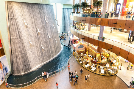 DUBAI, UAE - JANUARY 10, 2015: artistic waterfalls in Dubai Mall, the world