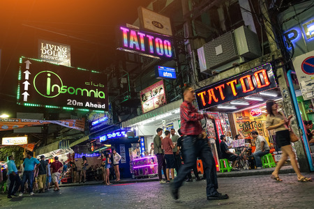 PATTAYA, THAILAND - JANUARY 17, 2015: multicolored neon signs near Insomnia Disco on the Walking Street of Pattaya. The street is closed to the traffic from 6pm until late in the night Редакционное