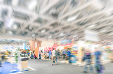 Blurred defocused trade show stand with radial zoom defocusing - Business concept tradeshow for international meeting exchange