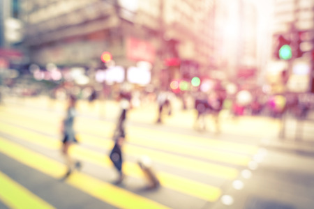 Blurred defocused abstract background of people walking on zebra crossing with vintage marsala filter  Banque d'images