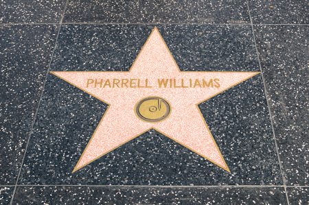 LOS ANGELES - 21 MARCH, 2015: star of Pharrel Williams on the Walk of Fame in Hollywood California. The grammy winning singer songwriter and producer received the celebrity sign at the end of 2014.