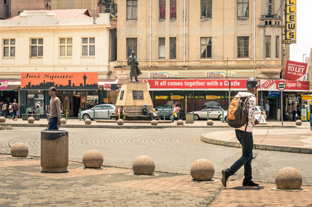 JOHANNESBURG, SOUTH AFRICA - NOVEMBER 13, 2014: everyday life at Gandhi square. After the renovation finished in 2002 the area got a renovated bus terminal , 24-hour security, and many new shops .