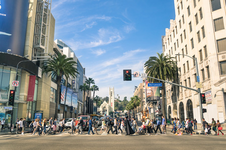 LOS ANGELES - MARCH 21, 2015: crowded street with multiracial people walking on Hollywood Boulevard the world famous Walk of Fame created in 1958 as a tribute to artists working in the movie industry.