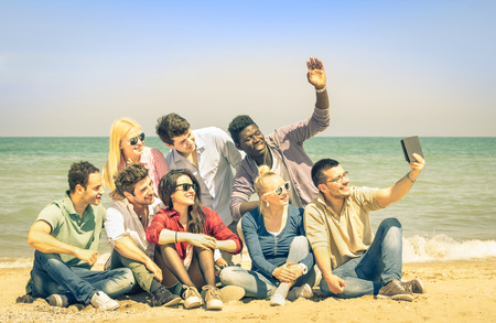 telephone together: Multiracial happy friends taking selfie with tablet at beach - Multi ethnic concept of happiness and modern friendship all together against racism for peace and fun - Saturated vintage filtered look