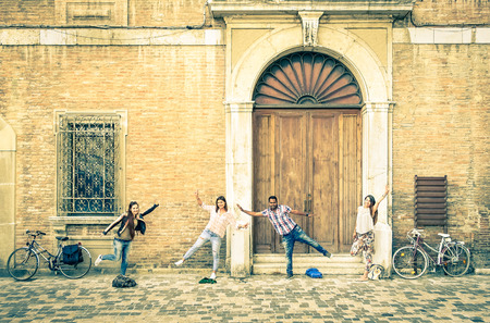 vintage travel: Young hipster best friends having fun posing in classic ranaissance area - Youth concept and friendship with people alternative lifestyle - Guys and girls together in the city - Vintage filtered look