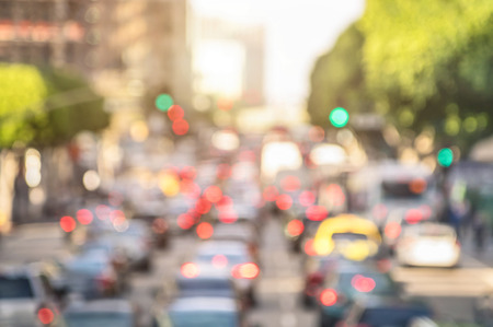Rush hour with defocused cars and generic vehicles - Traffic jam in Los Angeles downtown - Blurred bokeh postcard of american iconic city with bright daylight colors - Real life transportation concept