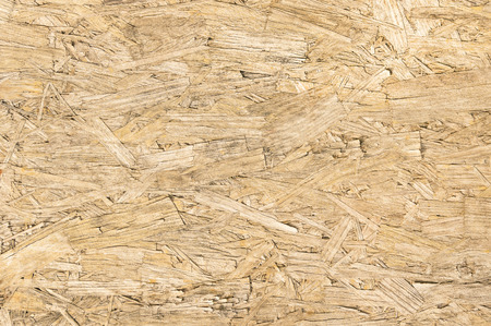 isolation backdrop: Chipboard wood and alternative construction material - Texture on wooden panel in construction yard - Retro seamless backdrop pattern - Pressed particleboard for house isolation coating Stock Photo