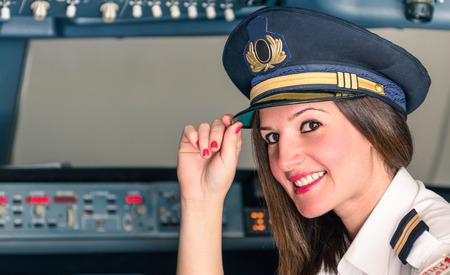 piloto: Piloto de sexo femenino joven listo para el despegue