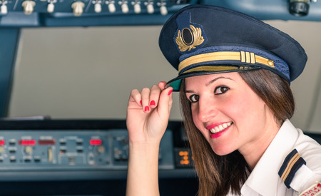 airline pilot: Young female Pilot ready for Takeoff