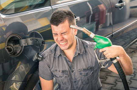 metaphor: Young adult shooting himself over crazy petrol and fuel prices.