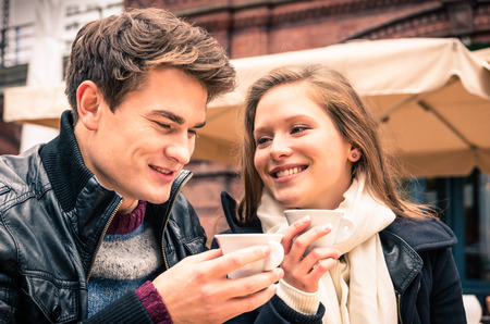 best friends: Young Couple lovely enjoying a cup of Coffee Stock Photo
