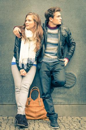 winter break: Modern fashion Couple in a moment of mutual Disinterest