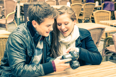 love pic: Couple of lovers watching photos on a digital camera