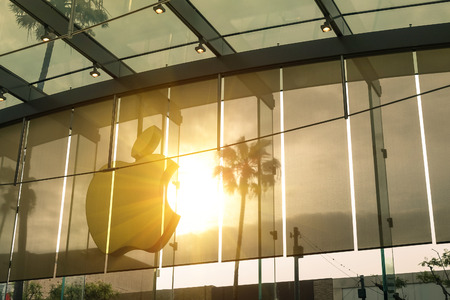 apple symbol: LOS ANGELES - 19 MARCH 2015: sunset silhouette of main logo at Apple store on 3rd Street in Santa Monica. The chain owned and operated by Apple Inc is dealing with computers and electronics worldwide
