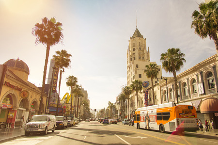 LOS ANGELES - MARCH 21, 2015: front view of world famous Walk of Fame on Hollywood Boulevard before sunset in LA California. Warm nostalgic filter with late afternoon color tones and natural sunflares