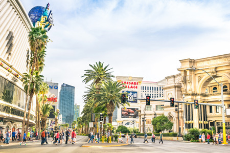 frontal views: LAS VEGAS - MARCH 23, 2015: multiracial people walking on The Strip, the world famous Las Vegas Boulevard South, mostly known for its concentration of resort hotels and casinos along the street route. Editorial
