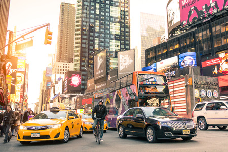 new york city times square: NEW YORK - MARCH 25, 2015: yellow taxi cab and rush hour congestion at Times Square in Manhattan downtown before sunset - Intersection of 7th Avenue with 43rd Street - Warm filtered editing