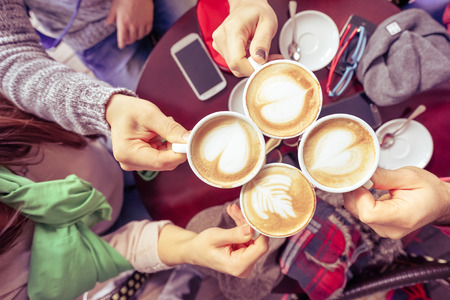 friends together: Group of friends drinking cappuccino at coffee bar restaurant - People hands cheering and toasting with upper view point - Social gathering concept with men and women - Vintage marsala filtered look