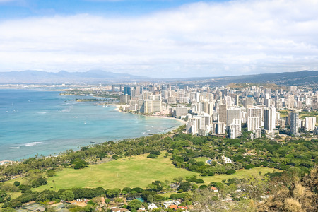 Panorama skyline view of Honolulu city and Waikiki beach in the pacific island of Oahu in Hawaii - Postcard from Diamond Head crater of exclusive travel destination - Sunny afternoon color tones Stock Photo