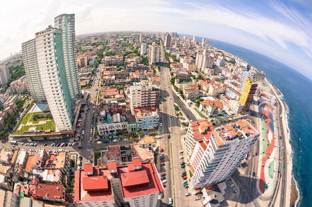saturated color: Bird eye aerial view of Havana city capital of Cuba in latina america - Detail of skyscrapers in modern downtown business district - Skyline with fisheye lens distortion and warm saturated color tones