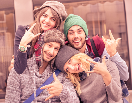 funny people: Best friends taking selfie outdoors with funny face expression and fashion clothes - Happy friendship concept with young hipster people having fun together - Vintage marsala filtered color tones