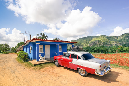 bel air: VAL VINALES, CUBA - NOVEMBER 20, 2015: vintage car Chevrolet Bel Air parked at farmer bungalow in the country side of Cuba in the province of Pinar del Rio - Warm afternoon color tones