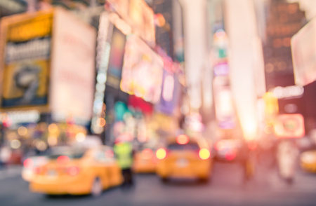 taxicabs: Traffic jam with defocused yellow taxi cabs and rush hour on Times Square in Manhattan downtown at sunset - Blurred bokeh postcard of New York City on a vivid bright marsala color filtered look