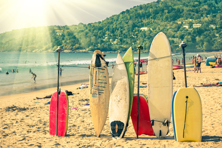 kata: Multicolored surfboards at  Kata Beach in Phuket Island - Surf boards at tropical exclusive destination in south east Asia - Wonders of Thailand on vintage filtered look with enhanced sunshine Stock Photo