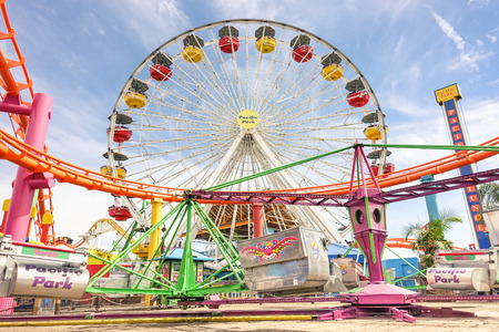 LOS ANGELES - 18 MARCH 2015: detailed frontal view of multicolored ferris wheel at Santa Monica Pier at Pacific Amusement Park - Landmark on the californian coast at the foot of Colorado Avenue