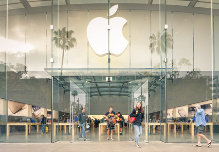 company logo: LOS ANGELES - 19 MARCH 2015: Apple store on 3rd Street Promenade in Santa Monica CA United States. The retail chain owned and operated by Apple Inc is dealing with computers and electronics worldwide