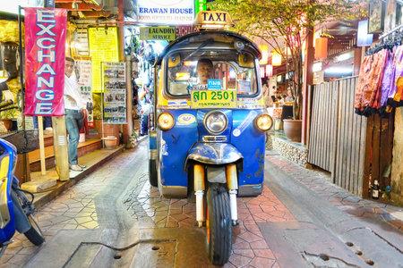 auto rickshaw: BANGKOK, THAILAND - 2 FEBRUARY 2016: typical auto rickshaw taxi worldwide known as  tuk tuk  in narrow street at Khao San Road - Beating heart of travelers movida in the center of Thailand capital Editorial