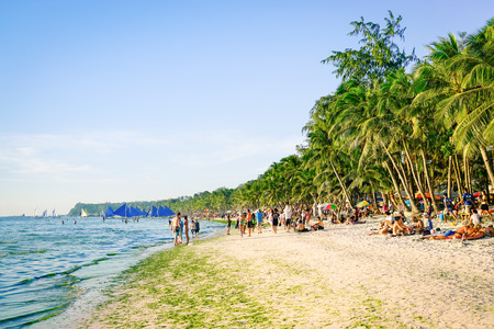 philippines: BORACAY, PHILIPPINES - 13 FEBRUARY 2016: tourists and everyday life in Boracay - Exclusive destination islands in Philippines - Travel concept with white sand beach and blue ocean in south east Asia