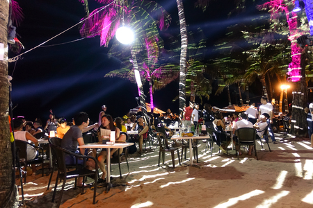 BORACAY, PHILIPPINES - 12 FEBRUARY 2016: multiracial tourists chilling at beach restaurant bar in Boracay - Travel concept with people travelers from all over the world Editorial