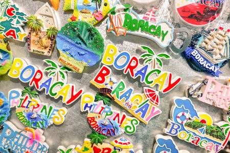 souvenir: BORACAY, PHILIPPINES - FEBRUARY 16, 2016: souvenir fridge magnets for sale at night flea market in Boracay beach Station 2 - World famous south east asia travel destination - Focus in middle of frame