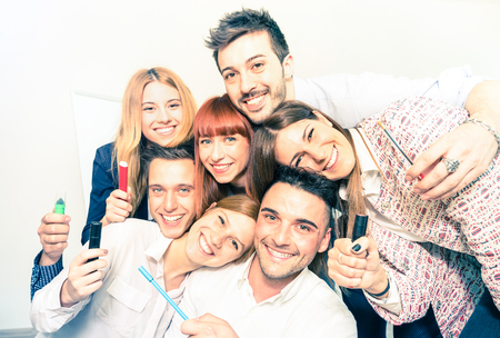 Group of happy people employee workers taking selfie - Business concept of human resource on working fun time - Start up entrepreneurs at office - Bright desaturated filter with focus on low right guy