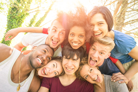 multi racial group: Best friends taking selfie outdoor with back lighting - Happy youth concept with young people having fun together - Cheer and friendship against racism - Vintage marsala filter and sunshine halo flare