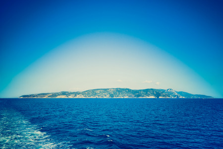 banding: Deep blue filtered vignetted panorama view of Argentario peninsula on the Tyrrhenian Sea - Nature wonder in Tuscany Italy and Mediterranean Sea from tail of ferry boat - Lomo filter with soft banding